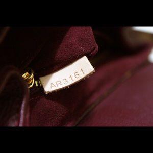 louisvuitton purse. brown monogram